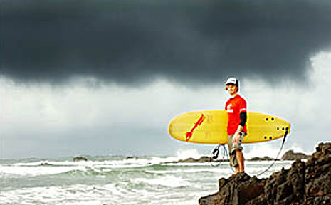 Nathan Folkes, of Byron Bay's rain-hit Mojosurf and Dolphin Kayaking, is praying for a sunny, tourist-filled summer.