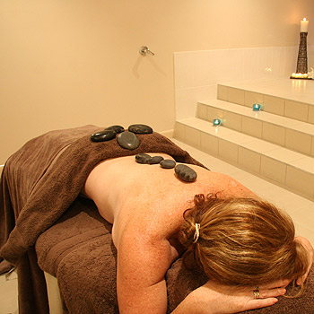 A hot rock massage, candles and burning oils all contribute to a relaxing spa experience at Ocean Serenity.