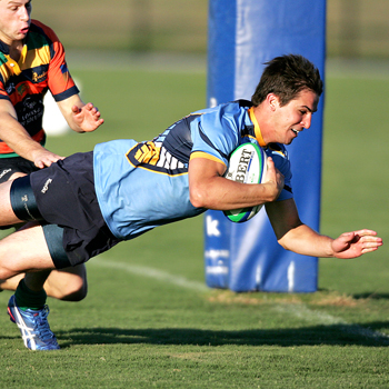 Brock Gibbon smiles as he flies over the try line in the Sunshine Coast Stingrays vs Gold Coast Breakers game at Stockland Park, Kawana. Photo: Brett Wortman/175426