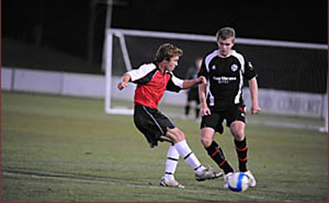 Carl Robinson (left) in action for the Richmond Rovers against North Companions.