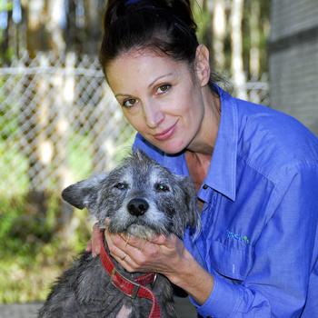 RSPCA Noosaville refuge attendant Kitty O`Brien with abandoned dog Benson. Photo: Geoff Potter