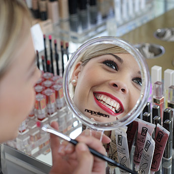When economic times turn bad, lipstick sales go up according to the 'lipstick index', because it's a luxury women like Katie Babos from Napoleon Perdis can afford and it makes them feel good. Photo: Cade Mooney/175441