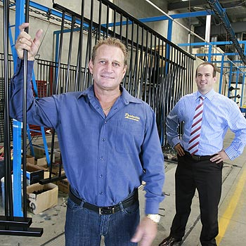 Protector Aluminium owner Darryl Cardell, with Matt Richards from Accounting North, says his company took a