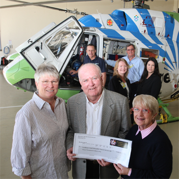 SCCAB members Raelene Boyle and SCCAB chairperson Joan Sheldon hand over the cheque to Energex Community Rescue Helicopter services Don Moffatt. Rear: Rob Walford, CEO of ECRHS, SCCAB members Marian Hall , Simon Gamble and Carolyn Tucker.