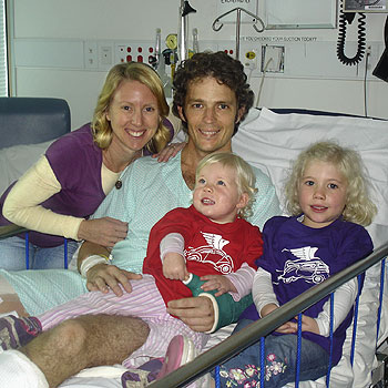 Stacey and Tony Enchelmaier with their children Grace and Joy in Royal Brisbane Hospital. Photo: contributed.