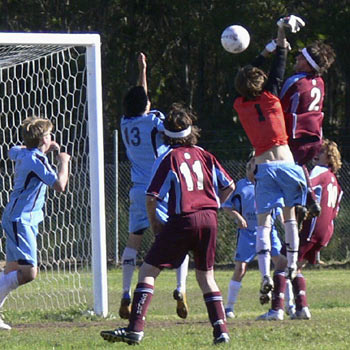 Dylan Wesarg outjumps the Maroochydore keeper, with Mattie Hynes looking on. Inset: Coolum's Carlos Nery takes on the Maroochydore defence.