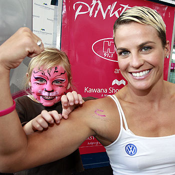 Four-year-old Lillyana Lucas, of Golden Beach, meets Gladiator Nitro, aka Hayley Bateup, at the launch of Pinktober. Photo: Barry Leddicoat/175525
