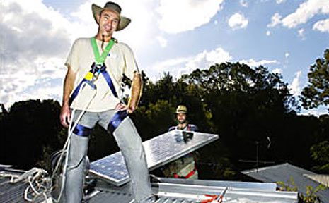 Mick Hickey and Shaun McIntyre from Beyond Bulding Energy, fitting solar panels to homes in Mullumbimby.
