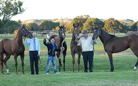 Lismore Turf Club secretary Michael Timbrell, jockey Matthew Chadwick and Coffs Harbour trainer Brett Bellamy with the winning horses.