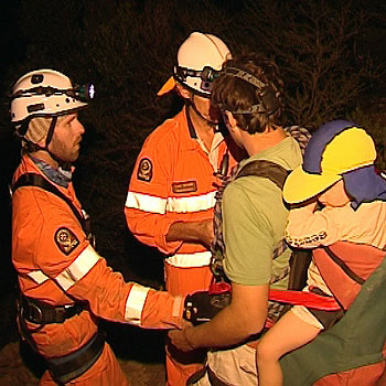 Members of the Glasshouse Mountains SES help rescue Jonathon Lowe and his two sons, aged four and two, from Mount Tibrogargan. Photo: courtesy of WIN News.