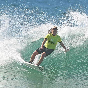 Sunshine Coast top gun Dimity Stoyle carves a clean turn en route to winning the open women's division at the Lizzy Surf Series. Photo: Surfing Queensland