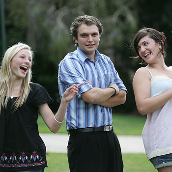 Jackie Maker and Jess Reid, both 16, practice their dance moves with party organiser Tom Turner at the Events Centre Caloundra. Photo: Chris McCormack/175408a