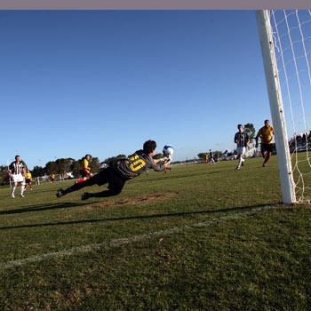 Logan goal-keeper Seb Usai had his hands full during the game against Sunshine Coast Fire. Photo: Jason Dougherty/175750