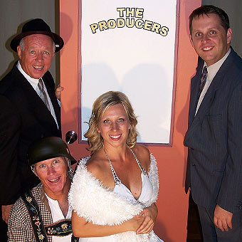 Tim Page, Frank Wilkie, Sonia Petrack and Scott Patzwald prepare for their roles in Mel Brooks's award-winning show,The Producers.