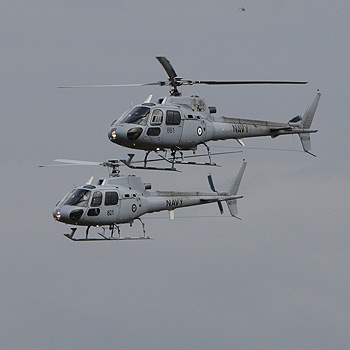Royal Australian Navy Squirrel helicopters perform aerial displays over Caloundra yesterday. Photo: Cade Mooney/175859