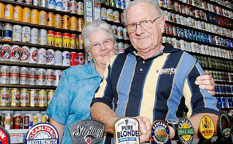 Gwenda and Warwick Shinner of Pimlico with part of their huge collection of beer cans.