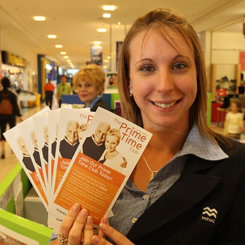 Kawana ShoppingWorld's Hayley Michelmore with some of the Prime Time discount cards available for over 50s. Photo: Nicholas Falconer/175894