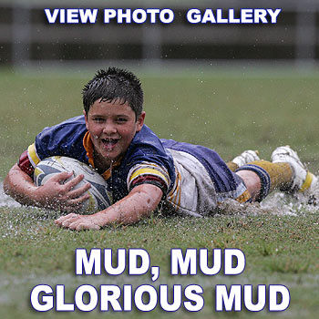 Sunshine Coast captain Tim Venning practises his try scoring in the sloppy conditions during the Vic Jensen 11 Years Rugby League Carnival. Photo: Brett Wortman/176913U