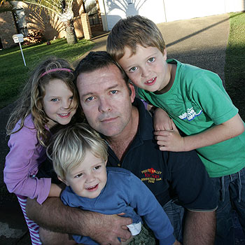 Dave Gaffney – with children James, 2, Ella, 5, and Jack, 7 – believes he is the victim of dictatorial bureaucracy. Photo: Chris McCormack/176945b