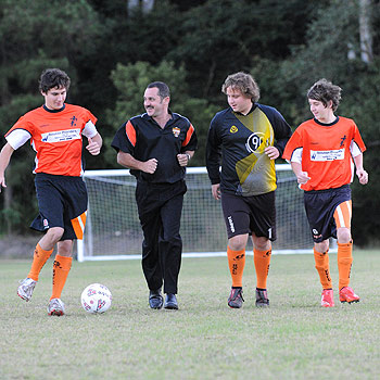 Soccer playing family the Townsends: Aaron, 17, dad Gary, Ryan, 17 and Dylan, 15 practising at Ballinger Park, Buderim. Photo: Chris McCormack/176928