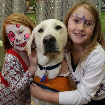 Jayda and Kyra Murray with guide dog ambassador Archie at Specsavers in Kawana Shoppingworld. Photo: Cade Mooney/177005