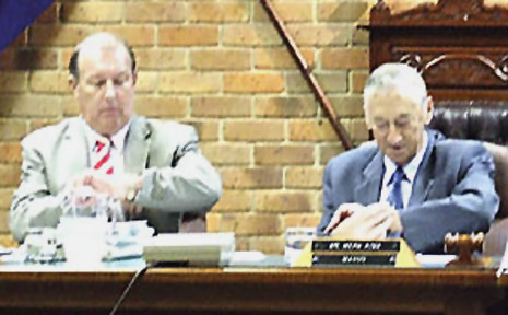 Lismore City Council General Manager Paul O'Sullivan (left) and Mayor Merv King check their watches on Tuesday night.