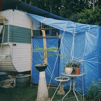 Derelict caravans at the Woombye Gardens Caravan Park reveal the harsh reality of Queensland's affordable housing crisis.