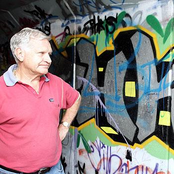 Neighbourhood Watch coordinator John Harrison is disgusted at the amount of graffiti along the Sunshine Motorway. Photo: Jason Dougherty/177101