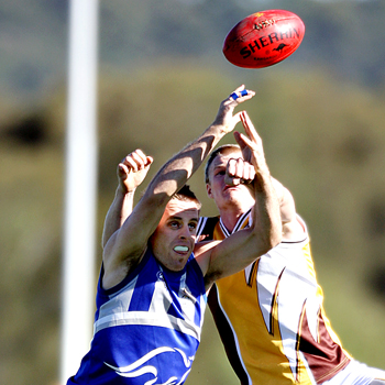 Maroochy Roo Ben Stanley leaps with Aspley's Matthew Clarke. Photo: Jason Dougherty/177109