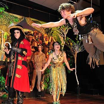 Jahmine Davine as Hook, Ben Wright as Peter Pan, and Brigid Langford as Tinkerbell in Nambour High School's production of Peter Pan. Photo: Brett Wortman/17116d