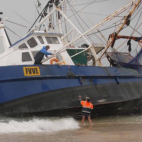 Friends retrieve gear from the stranded trawler Miss Melissa at Mooloolaba. Photo: Warren Lynam/177217