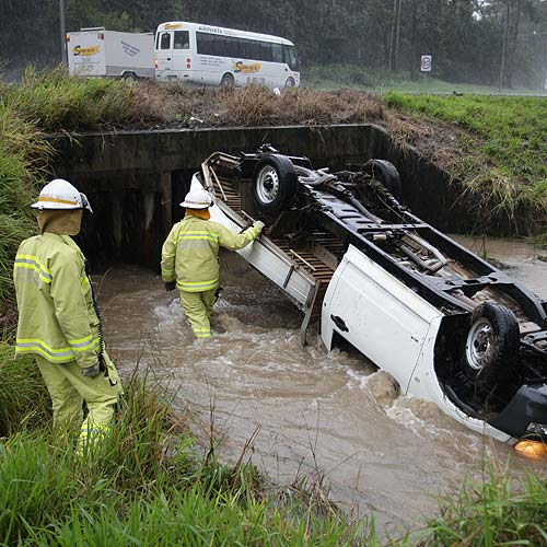 This ute flipped into a drain in the centre of the Bruce Highway after skidding off the road near the Mooloolaba exit. Photo: Michaela O'Neill/ 177230