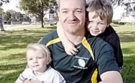 Organiser of the newly formed Southern Cross Deaf Rugby Union team Simon Mahony with his two sons, Elyija and Dakin.