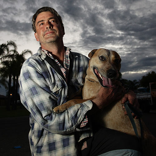 Shane Kuzniak with the stray dog he was forced to look after on the weekend. Photo: Cade Mooney/177289c