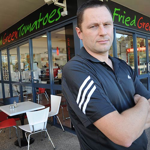 Chancellor Park cafe owner Andrew Collins is unhappy with a huge spike in the cost of his food hygiene licence this year. Photo: Chris McCormack/177320a