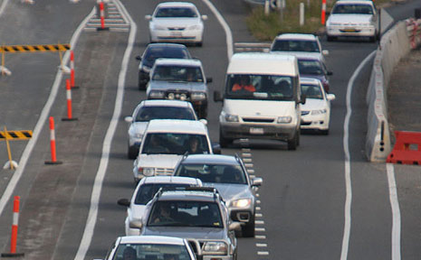 Traffic merges from the Maroochydore roundabout onto the northbound lane of the Sunshine Motorway as upgrades continue on the double laning.