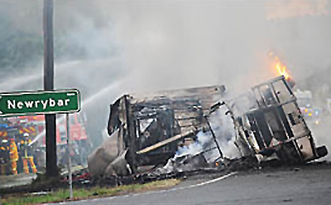 The burning B-double which closed the Pacific Highway late yesterday near Newrybar following an accident with two cars.