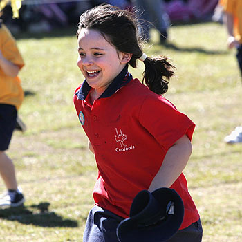 Willow Auricht-Ramage shows the sheer joy of running. Photo: Mike Garry/scw1021e