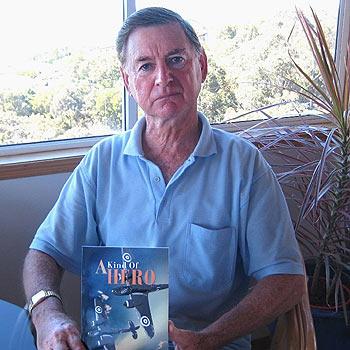Coolum author John R Nunn with his book, A Kind Of Hero.