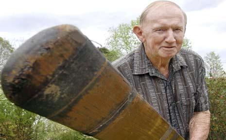 Ray Savins and his grandfather's cricket bat.