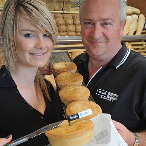 Dough Fusion owner Graham Martin and staff member Siarne Loeve with Australia's best meat pies. Photo: Brett Wortman/178626