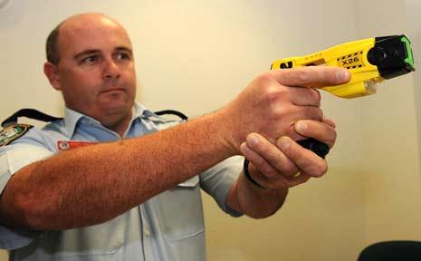Inpector Scott Bingham demonstrates the new X26 Taser.