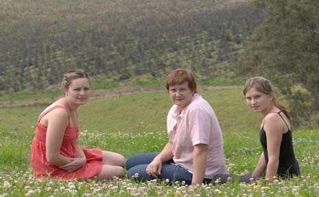 Karen Spencer and her daughters Hayley, 18 (left), and Natalie, 12, look over the new Boomi Creek tree plantation.