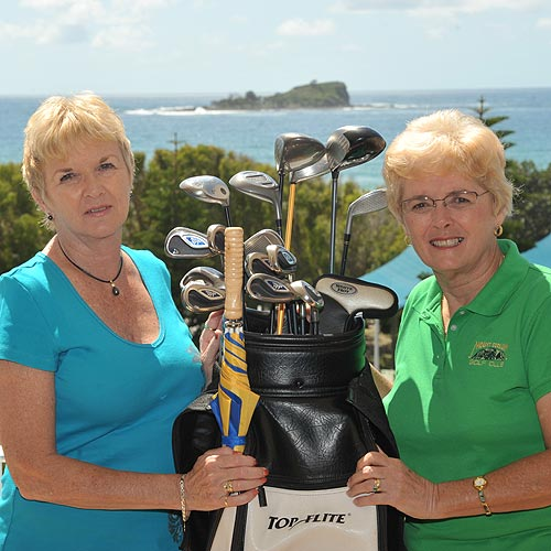Libby Troy, left, donates her late husband's clubs to Mount Coolum Golf Club's Bev James, to auction off  for breast cancer research. Photo: Brett Wortman/178860