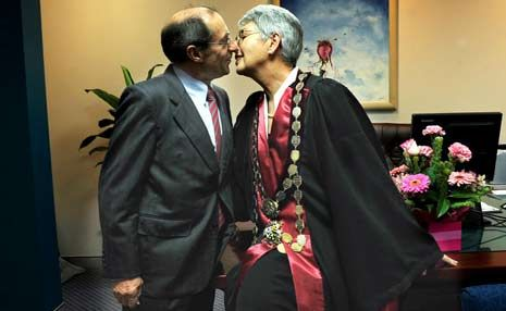 Lismore Mayor Jenny Dowell, complete in mayoral robes, gets a kiss from her proud husband Ron Dowell in the mayor's office.