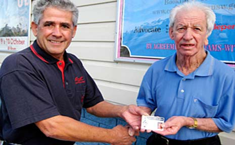 Grahame Williams presents Lloyd Erwin with his Lifetime Entry Card.