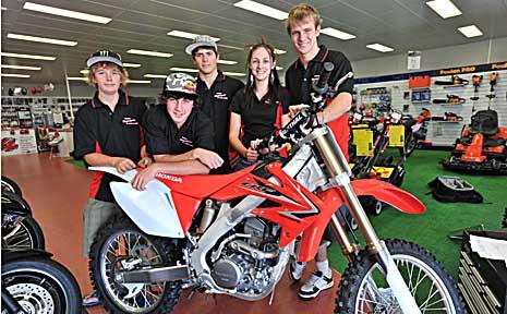 Scott Anlezark (centre) celebrates his new sponsorship at Coffs Harbour Honda.