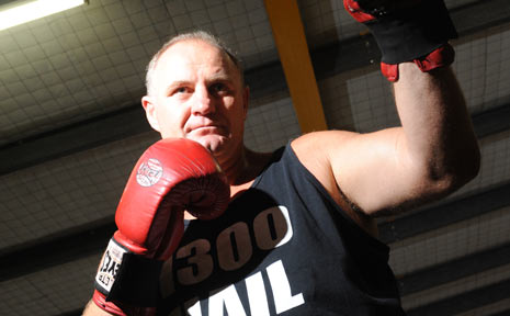 Bob Mirovic pounds the punching bag in preparation for his next bout.