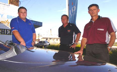 Josh Oliver (left), of Go Motors, Brett Robertson, of North Coast Wholesale Cars, and Kevin Handcock, of Perkins Caravans, say furnace soot from Norco is affecting their businesses.