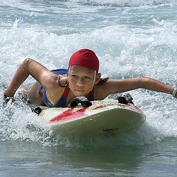 Jaleesa Vincent catches a wave at Coolum.